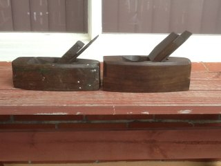 Side view of a pair of Kennedy Coffin Smoother Planes